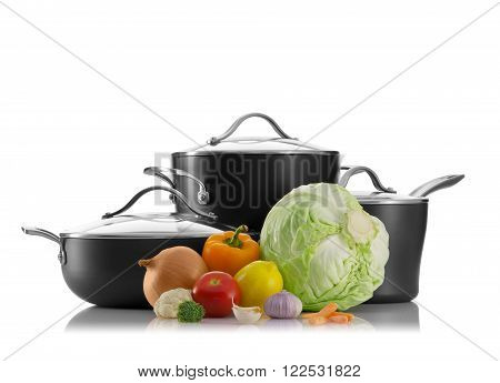 close up view of nice pots with some vegetables on white back