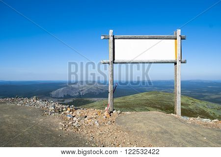 Blank billboard in the mountains. Finland Lapland
