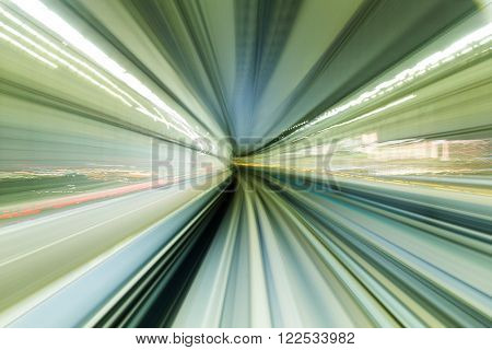 Train moving fast in tunnel at night