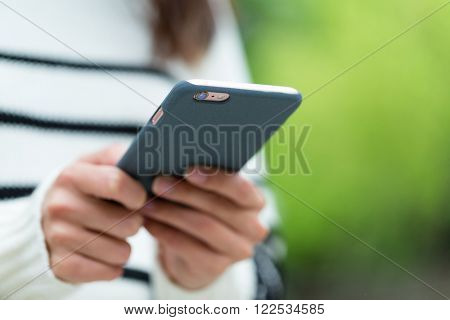 Woman using cellphone for sending text message
