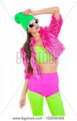 Trendy girl posing in vivid colourful clothes and sunglasses. Party style. Bright fashion. Optics, eyewear. Isolated over white.