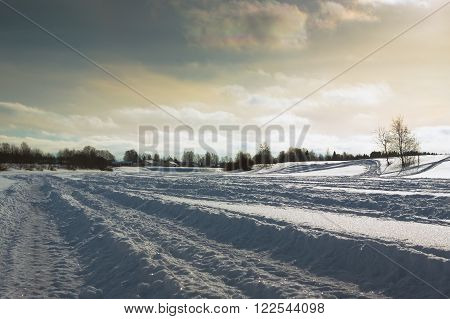 Snowmobile tracks leading to the horizon on the river ice in the wintertime in the Northern Finland.