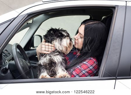 Girl With Dog In The Car