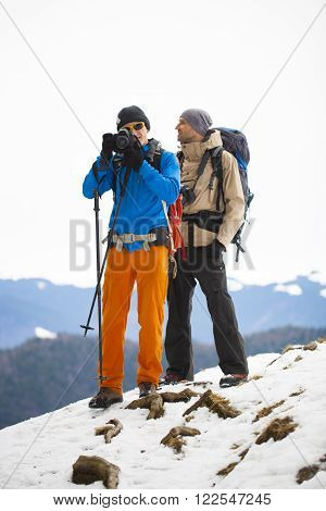 Two Photographers At Work.