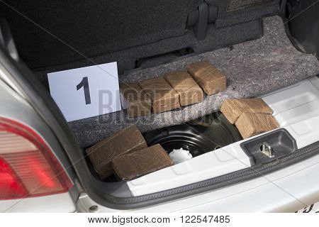 Illegal drug trade in the trunk of a car