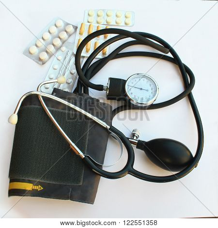 shot of tonometer and pills blood pressure theme