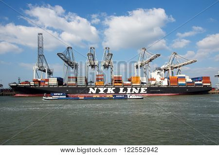 ROTTERDAM NETHERLANDS - MAR 16 2016: Container ship Nyk Oceanus from NYK Line moored at a container terminal in the Port of Rotterdam.