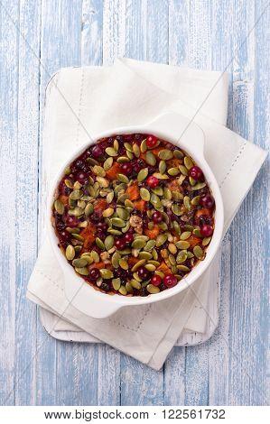 Millet pumpkin gratin with cranberries walnuts and pumpkin seeds