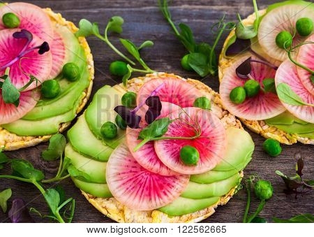 Organic quinoa cakes with avocado and watermelon radish for breakfast