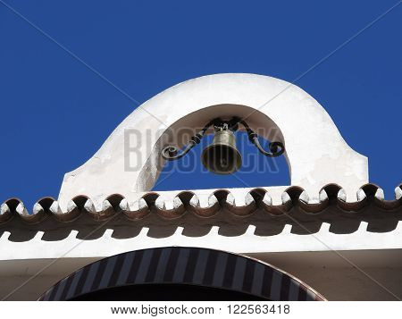 Close-up of belfry and bell in Fuengirola Andalucia