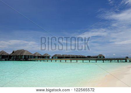 Beautiful beach with water bungalows at Maldives