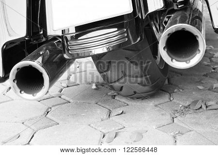 Motorcycle double exhaust black and white background