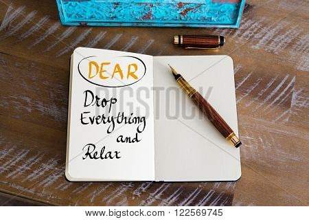 Retro effect and toned image of a fountain pen on a notebook. Business Acronym DEAR as Drop Everything and Relax as business concept image