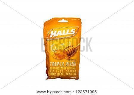 Winneconne WI - 7 February 2015: Bag of Halls cough drop's honey lemon flavored.