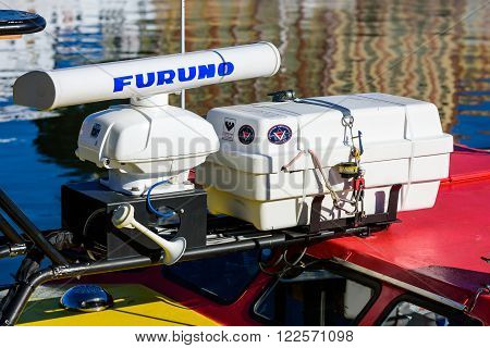 Kalmar Sweden - March 17 2016: The radar and inflatable life raft of a small rescue boat. Furuno logo on radar and Viking logo on life raft.
