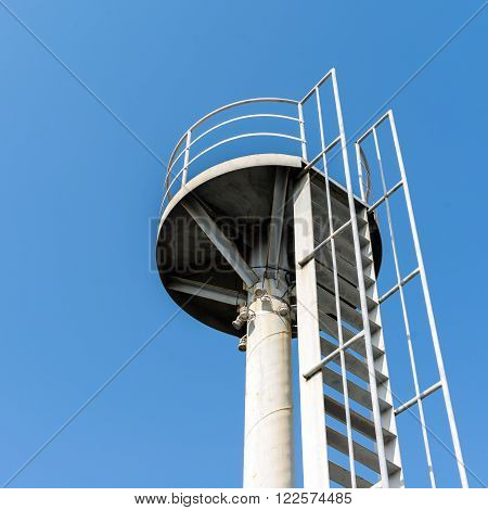 Elevation shooting metal watchtower under the blue sky background