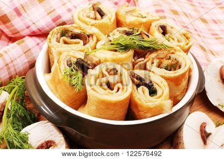 Pancakes with mushrooms. Mushroom appetizer. Russian Shrovetide