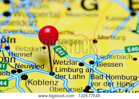 Photo of pinned Limburg an der Lahn on a map of Germany. May be used as illustration for traveling theme.