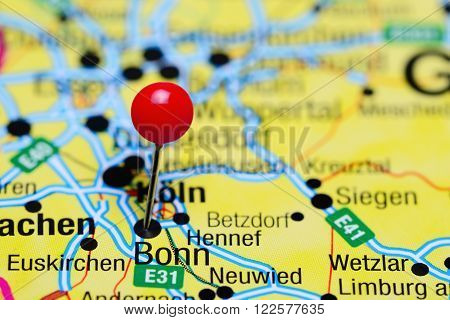 Photo of pinned Bonn on a map of Germany. May be used as illustration for traveling theme.