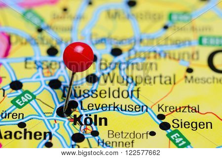 Photo of pinned Koln on a map of Germany. May be used as illustration for traveling theme.