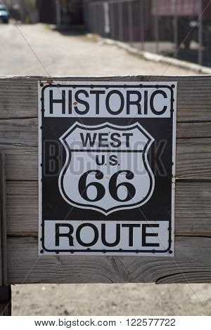 Black and white weathered Route 66 sign