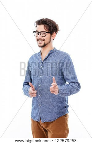 Happy casual man pointing finger at camera isolated on a white background