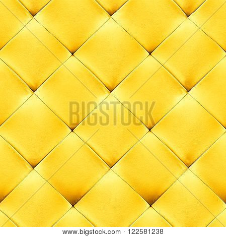 Yellow genuine leather upholstery background. Luxury pattern.