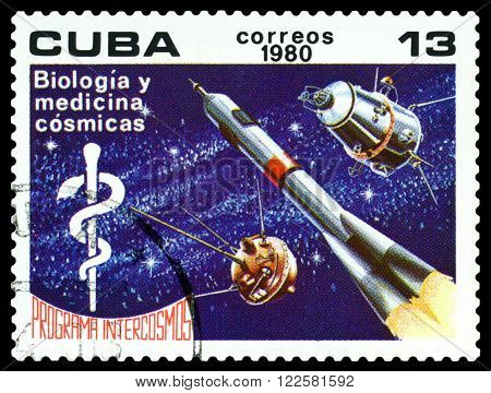 CUBA - CIRCA 1980 : a stamp printed in Cuba shows satellite and the rocket postage stamp devoted to the study of biology and medicine by Intercosmos program circa 1980 .