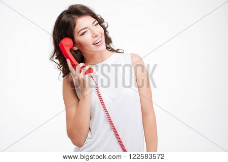 Smiling woman talking on the phone tube isolated on a white background