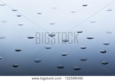 The pattern of the water droplets. The gradient deep blue. Background.