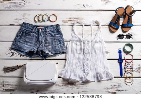 Woman's outfit with lace top. Summer outfit on showcase. Lady's casual outfit for summer. Very light outfit for girls.
