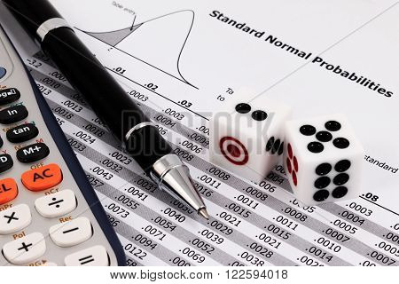 Two Dice, Calculator And Pen On Standard Normal Probabilities Table.