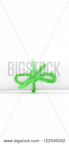 Handmade green string node tied on white letter package, isolated