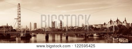 Thames River panorama with London Eye and Westminster Palace in black and white in London.
