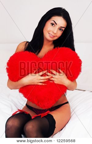 Beautiful Brunette Woman At Home Hugging A Big Fluffy Soft Heart. Feast Day Of St. Valentine