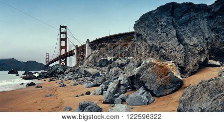 Golden Gate Bridge with rock panorama in San Francisco as the famous landmark.