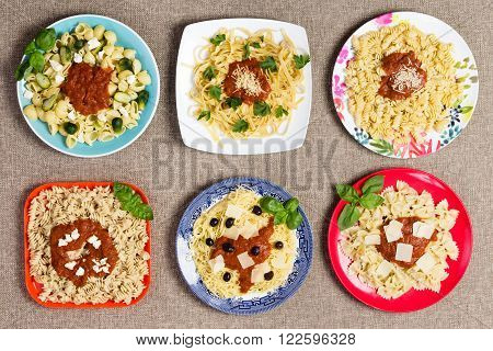 Various Pasta Dishes With Garnishes