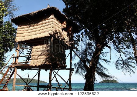 Reed House on poles in the beech in Koh Ron island in Cambodia just 10 meters from the sea
