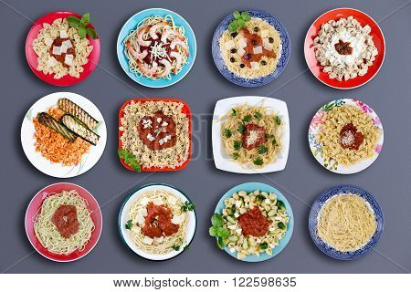 Top down view on twelve square and circular plates filled with various types of pasta topped with choice meats fish herbs marinara sauce cheese and other delicious ingredients