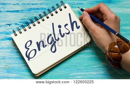English words learning education concept lettering posters writing notebook note grey wooden background Word refer news current affairs special occasions business planning beautiful vintage keys