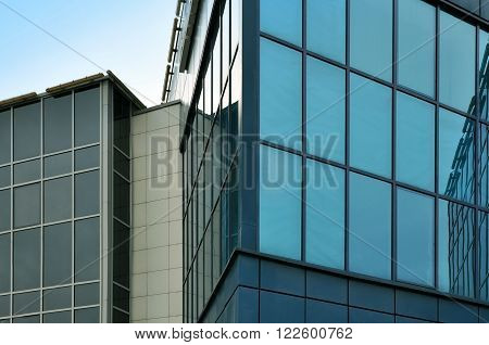 GRODNO, BELARUS - MARCH 7, 2016: Detail of the facade of modern bank. The planes of the facade of modern glass building with reflection. Grodno, Belarus.