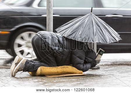 Beggar In The Rain With Umbrella Car