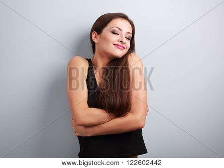 Happy Sporty Fit Woman Hugging Herself With Natural Emotional Enjoying Face. Love Concept Of Yoursel
