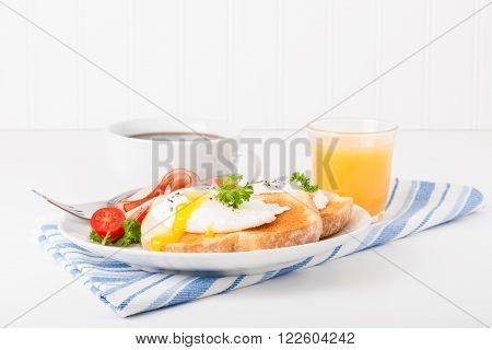 Perfectly poached egg on toast with ham.