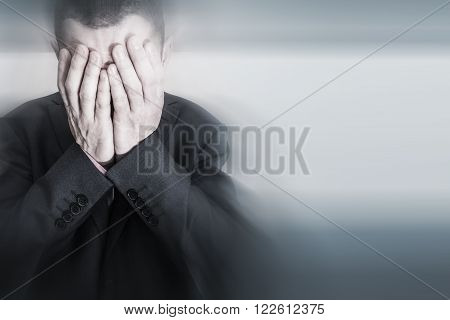 Depressed Caucasian Male in Elegant Black Suit. Depression of Businessman.