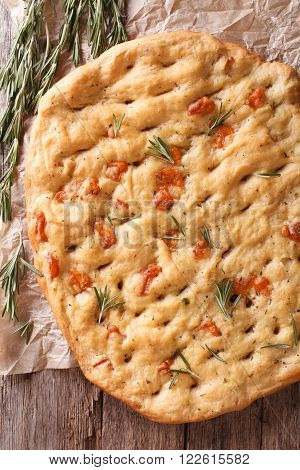 Freshly Baked Italian Focaccia With Rosemary Close-up. Vertical Top View