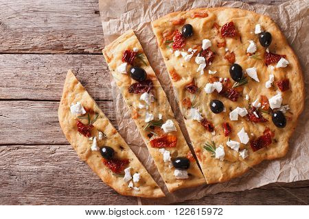 Focaccia With Dried Tomatoes, Feta And Olives. Horizontal Top View