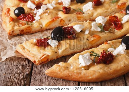 Sliced Focaccia With Dried Tomatoes, Feta And Olives. Macro Horizontal