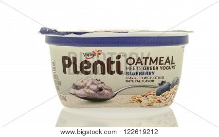 Winneconne WI - 5 March 2016: A container of Yoplait plenti greek yogurt with oatmeal in blueberry flavor.