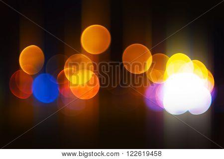 City light bokeh background urban street traffic at night colorful blur vehicle headlight circles